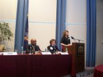 Alumna Kate McGuirl, '04 introduces distinquished panelists